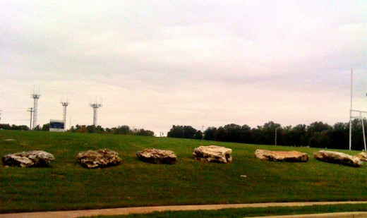 The football field bordered with rocks.