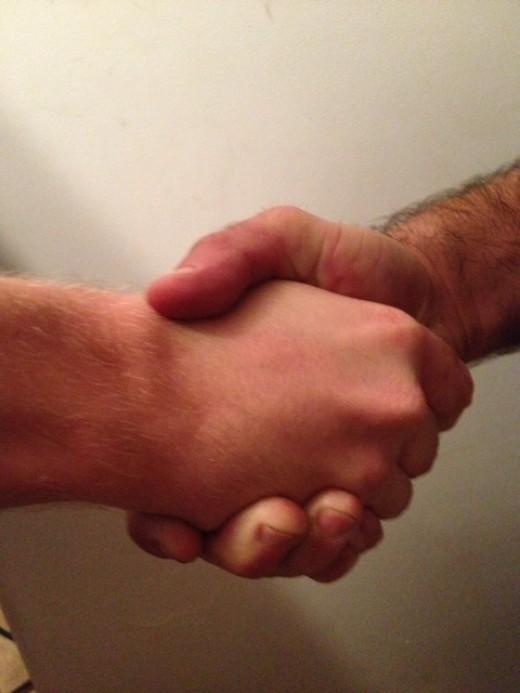 A handshake can demonstrate understanding and empathy between two people.