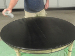 Applying the chalkboard paint to the table