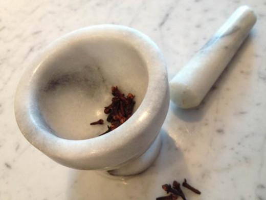 If all you have handy are whole spices, grind them in a mortar and pestle or a use a coffee bean grinder that's just for spices