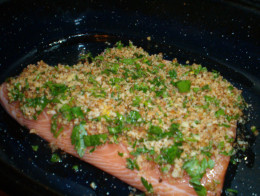 The crust added on top of a salmon fillet.