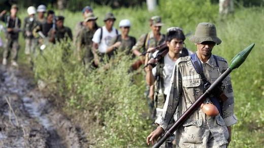 Members of MILF patrol their camp in Mindanao