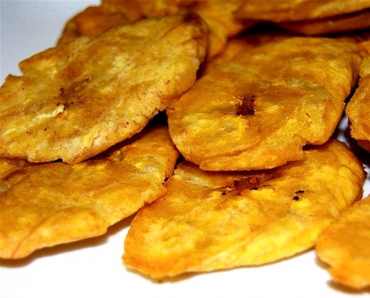 Tostones are easy to prepare by doubly frying slices of green, unripe ...