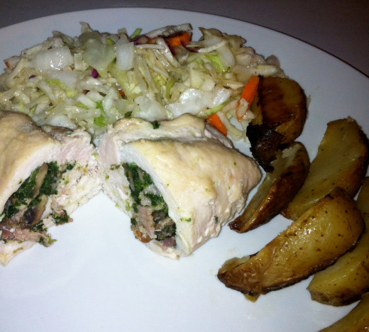 Chicken breasts stuffed with spinach, bacon and mushrooms. Served with homemade ranch roasted potatoes and coleslaw.