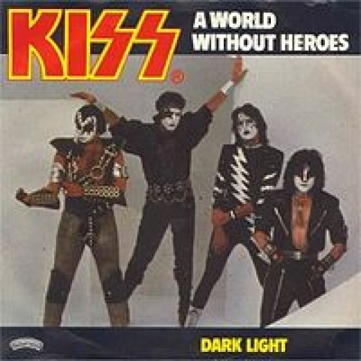"The ""A World Without Heroes"" single shows the band's streamlined new ""look."" I love Paul's purple headband and Wonder Woman bracelets!"