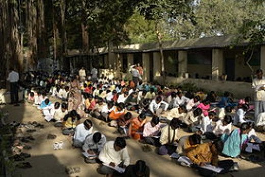 Students taking an exam in Mahatma Gandhi Seva Ashram, Jaura, India