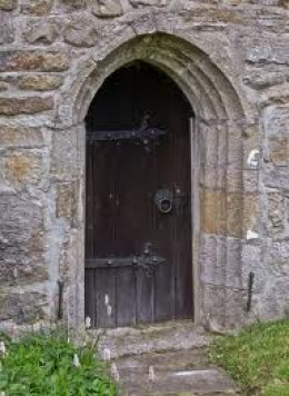 Church door of St Michael & All Angels at Hubberholme. Your route starts at...