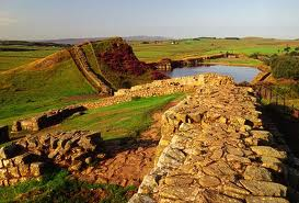Topography: Hadrian's Wall near Crag Lough, a large natural lake to the north of the wall. Still in Northumberland (the border's some way further north, past Kielder Water), Cumbria is way to the west past Haltwhistle