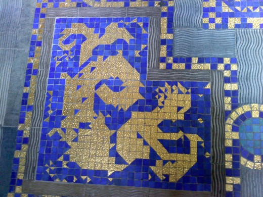 The golden molded tiles of the pool