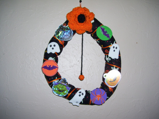 Craft foam and plastic spider rings finish off this wreath.
