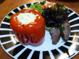 Stuffed Bell Peppers (Capsicums) served with lamb and salad.
