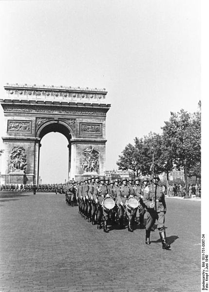 German military parade on Avenue des Champs-Elysees, June 1940. In the background is the Arc de Triomphe
