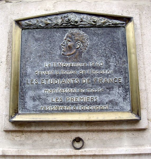 Plaque at No 156 Avenue des Champs-Élysées, Paris 8th, near the Arc de Triomphe, commemorating the first emergence of the French Resistance, on World War I Armistice Day, 11 November 1940, in the form of a demonstration by a large group of French stu