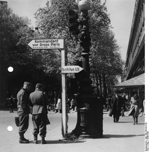Paris street scene, 1940, showing German installed street signs