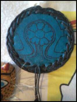 Leather Medallion with Mayan female symbol.