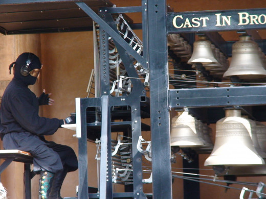 The carollon consists of severl cast bronze bells, connected to cables, and is played with a keyboard of sorts and foot pedals.