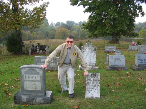 Daddy stands between the tombstones of two of his uncles.