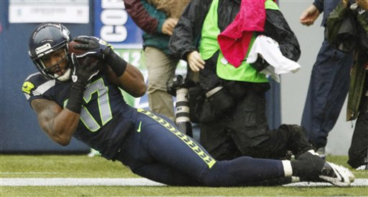 Braylon Edwards catches the ball for a touchdown against the New England Patriots Sunday, Oct. 14, 2012, in Seattle.