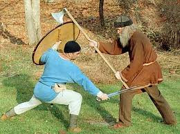Combat training, one man with short sword and shield, the other with two-handed war- or Dane-axe