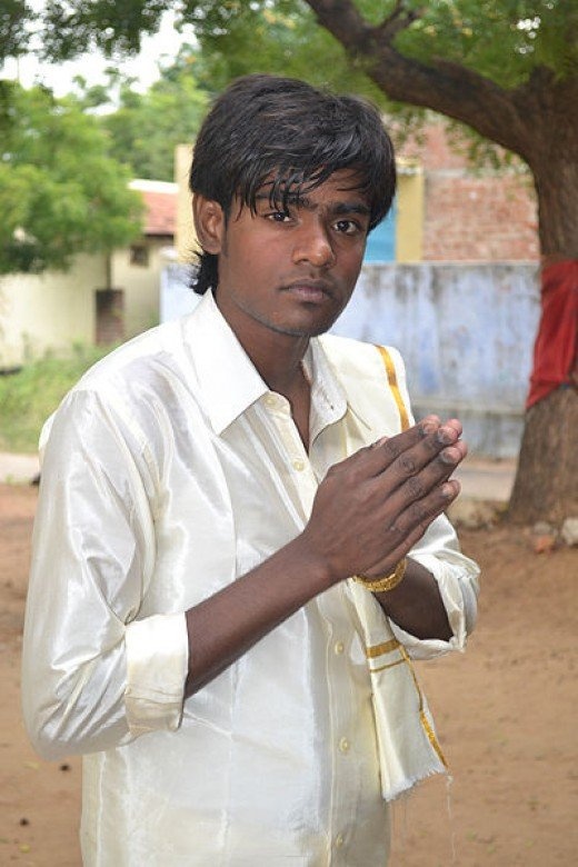 This Tamil youth making a greeting gesture was photographed by Livingston on January 6, 2012 in the state of Tamil Nadu (formerly the state of Madras) in India.