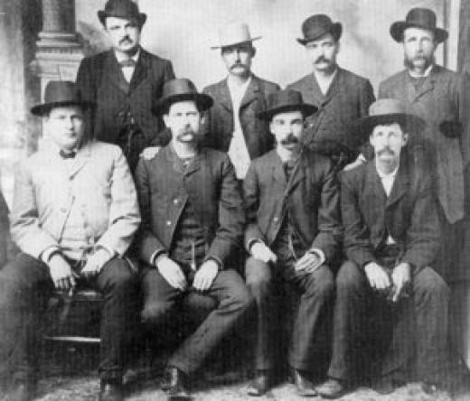 Conkling Studio,Dodge City, June 1883 Front Row: Charlie E. Bassett, Wyatt Earp, M. F. McLain, Neal Brown.  Back Row: William H. Harris, Luke Short, Bat Masterson, W. F. Petillon.