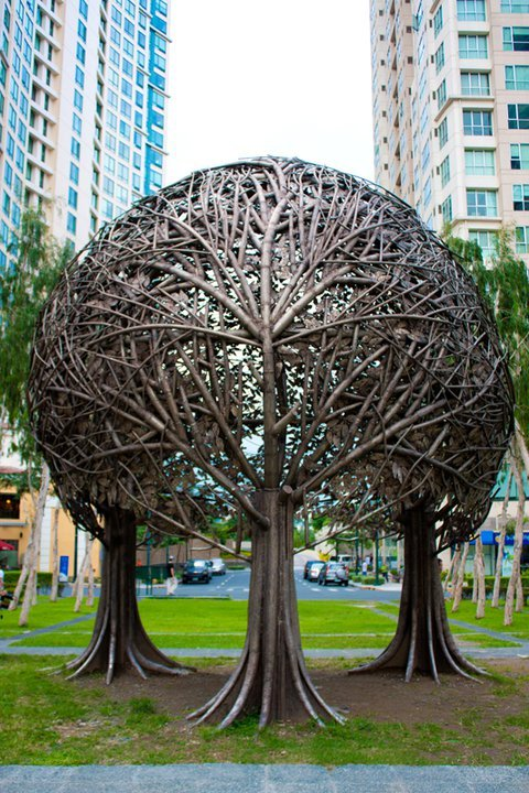 Crafted by Reynato Paz Contreras, The Trees is a canopy of three interlocking trees which stand as testament to Mother Earth and her strong, unifying nature.