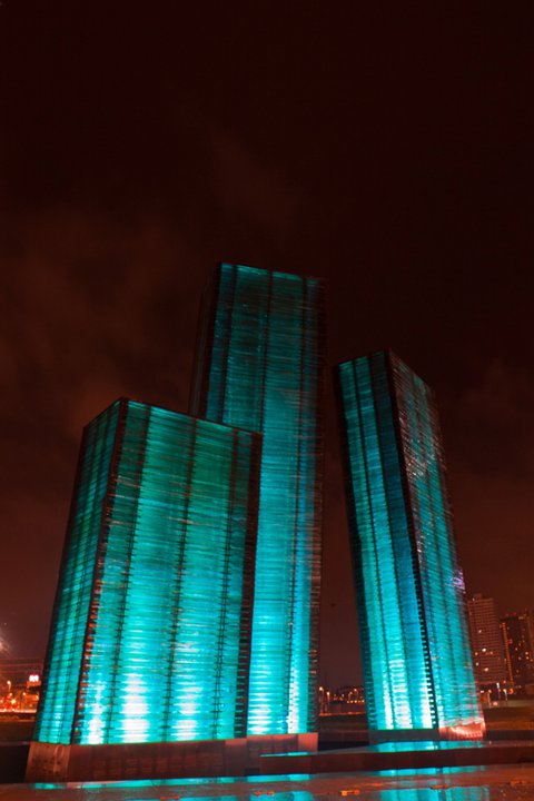 Transformation, by Architect Lor Calma, is a grand and breathtaking sculpture of stacked laminated glass, three forms each between 5 to 10 meters tall. They represent the Philippines' three main islands of Luzon, Visayas and Mindanao.