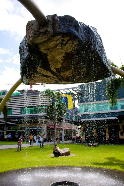 Specific Gravity, by Reg Yuson, is a suspended boulder fountain which highlights the connection between the audience as a mobile participant and their primordial affinity to gravity.