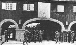 Main gate....at ocuupation by US forces....note the eagle and swastika above gate.