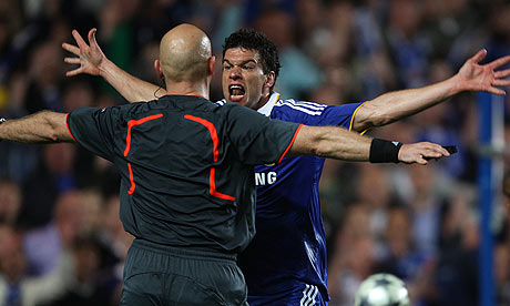 Michael Ballack appeals at Tom Henning for a clear penalty shout