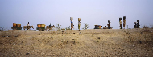 Safe water may require travel. Residents travel near Savelugu, Northern Ghana.