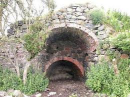 Limekiln front aspect. Lime burning provided a dry layer for growing crops on muddy land and surfacing for external walls