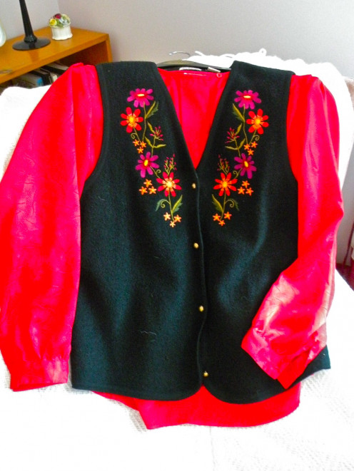 A bright blouse and embroidered vest can be part of your Gypsy Costume.