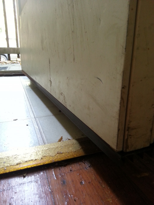 A gap can sometimes be present underneath a door. This would allow for heat to escape and insects to invade. Purchase a pad to nail to the bottom of your door to help eliminate these undesirables.