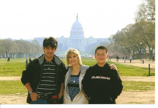 Vini, Donna, and Johnny pose in front of the U. S. Capitol.