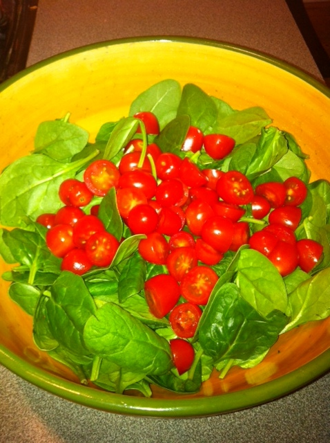Add tomatoes to spinach in seving bowl.