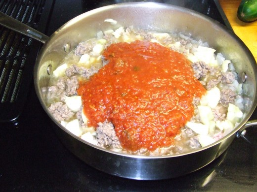 Add homemade tomato sauce.