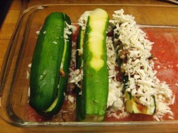 Stuff the hollowed out zucchini with the sauteed mixture then add cheese and tops.