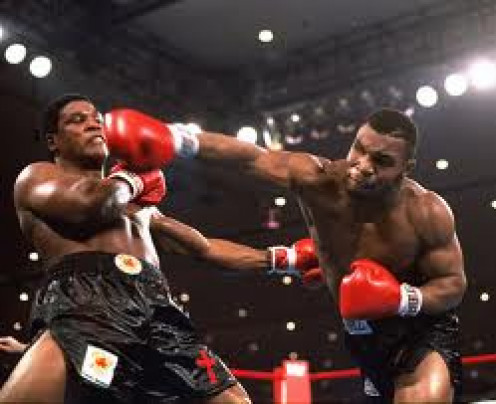 Mike Tyson knocking out Trever Berbick in 1986 to become the youngest Heavyweight Champion ever. It only took two rounds for Tyson to end matters with a violent left hook.