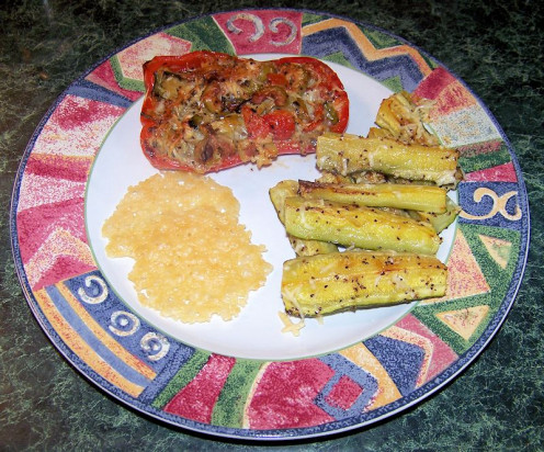 Tuscan stuffed bell peppers with zucchini side dish and Parmesan crisps.