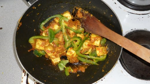 Paneer and green  pepper in a pan