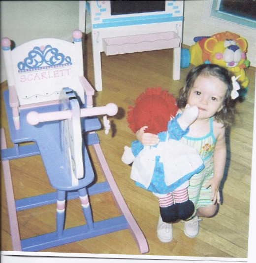 My oldest granddaughter and her rocking horse.