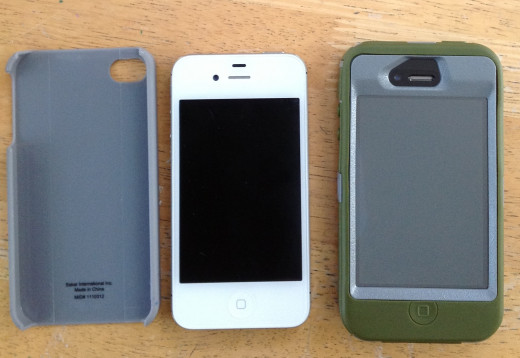 The simple shell, the uncovered iPhone, the Defender case on his phone.