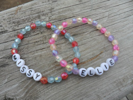 plastic beads with letter beads - the kids love these!
