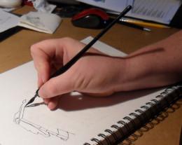 Ewan inking a design (it's fun to watch an artist work.)