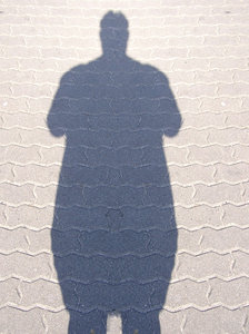A silhouette of an obese person