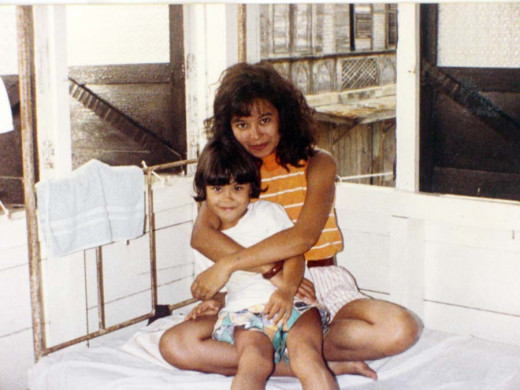 In one of the bedrooms on the second floor of the old house. In this photo: Me with my li'l cousin Kat.