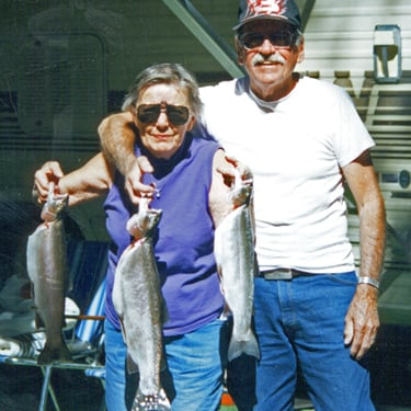 Mom caught the biggest fish but of course dad had to hold it for the photo.
