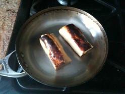 Farmer Cheese Blintzes fried in a skillet
