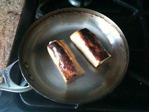 Farmer Cheese Blintzes fried in a skillet